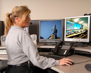 A police dispatcher working at console
